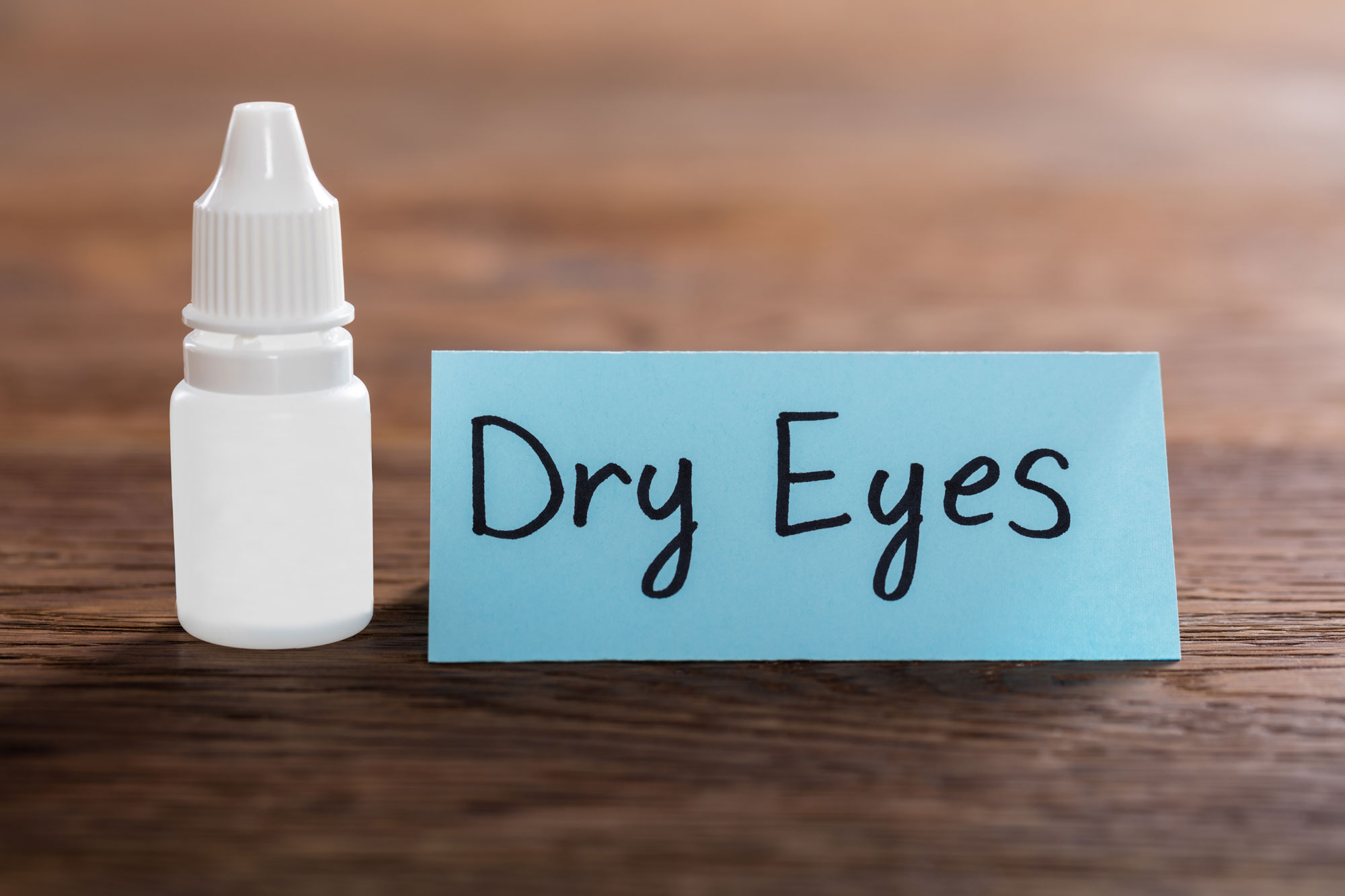 eye drops next to sign that says dry eyes